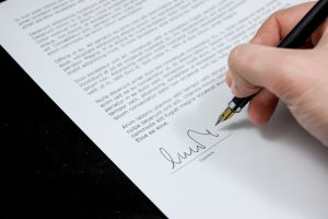 signing on a paper